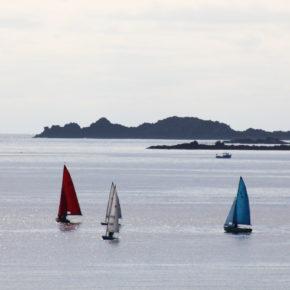 Three boats out at sea