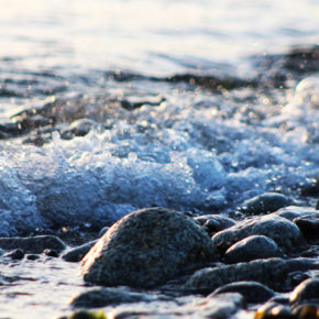 Seawater gently babbling over the pebbles