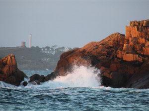 Waves gently crashing against the rocks